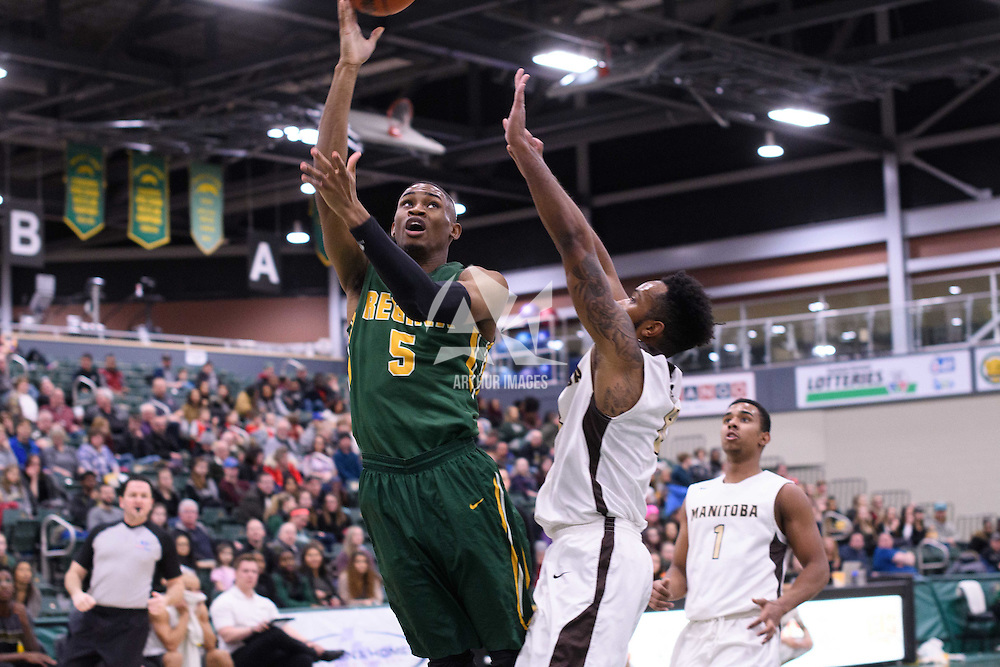 4th year guard Brandon Tull (5) of the Regina Cougars in action during the home game on January  14 at Centre for Kinesiology, Health and Sport. Credit: /Arthur Images