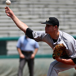 June 05, 2011; Tallahassee, FL, USA; UCF Knights pitcher Ben Lively (11) throws against the Alabama Crimson Tide during the first inning of the Tallahassee regional of the 2011 NCAA baseball tournament at Dick Howser Stadium. Alabama defeated UCF 12-5. Mandatory Credit: Derick E. Hingle