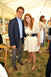 England football manager FABIO CAPELLO and PRINCESS BEATRICE OF YORK at a charity polo match organised by Jaeger Le Coultre was held at Ham Polo Club, Richmond, Surrey on 12th June 2009.