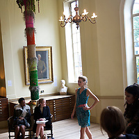 Models show the Saloni autumn/spring 2010/2011 collection during a fashion show held in the map room of the Royal Geographical Society, South Kensington, London on 20 September 2010.