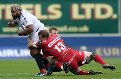 RC Toulon's Mathieu Bastareaud (left) is tackled by Scarlets' Hadleigh Parkes during the European Champions Cup, pool three mach at Parc y Scarlets, Llanelli.