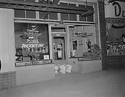 Y-580510A2.  Nick's Phoenix Inn, 1228 SW 3rd, SW 3rd & Main, May 10, 1958. 4:25 AM. Three toilets in doorway.