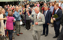 © Licensed to London News Pictures. 08/07/2014. Somerset, UK. Prince Charles at Glastonbury Market Place with Mick Jagger's brother who lives locally, Chris Jagger (pointing). Prince Charles has been visiting Glastonbury Abbey this morning 8th July 2014 as the first part of his visit to Somerset. Photo credit : Jason Bryant/LNP