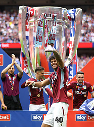 Aston Villa's Tyrone Mings celebrates after the final whistle