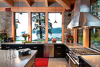 The ocean-side home features views of the open water from most rooms.