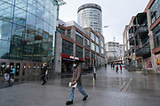 National coronavirus lockdown three begins at the Bull Ring Shopping Centre in Birmingham city centre, which is deserted apart from a few people walking down from the iconic Rotunda building on 6th January 2021 in Birmingham, United Kingdom. Following the recent surge in cases including the new variant of Covid-19, this nationwide lockdown, which is an effective Tier Five, came into operation today, with all citizens to follow the message to stay at home, protect the NHS and save lives.