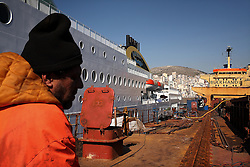Seafarer Lazic Zoran stands on board the deck of the Alfa K, a Mediterranean based bulk carrier with a Panamanian flag, as it undergoes repairs at the port of Piraeus in Greece on Feb. 20, 2008. Inspectors impose ITF-standard treaties on ship-owners to guarantee minimal standard working conditions for seafarers. They are on call 24 hours a day to address concerns from workers coming to port on the international ships.