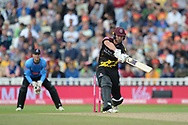 Corey Anderson of Somerset hits a six off the bowling of David Wiese during the Vitality T20 Finals Day semi final 2018 match between Sussex Sharks and Somerset County Cricket Club at Edgbaston, Birmingham, United Kingdom on 15 September 2018.