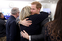 Prince Harry hugs journalist Bryony Gordon he as meets panelists and beneficiaries during the first Royal Foundation Forum in central London.
