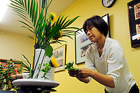 """Yumiko Aso from Aptos teaches """"ikebana"""" flower-arranging skills to attendees of a class at the 2012 Obon Festival at the Buddhist Temple of Salinas."""