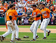 OSU's Trevor Boone and Joe Lienhard celebrating with teammates after their win over the West Virginia Mountaineers in the Big 12 Championship Game, Sunday, May 26, 2019 at the Chickasaw Bricktown Ballpark in Oklahoma City, OK.