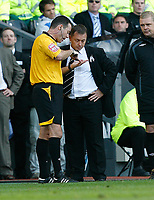 Photo: Steve Bond.<br />Derby County v Bolton Wanderers. The FA Barclays Premiership. 29/09/2007. Billy davies (R) has a refereeing decision explained by Mr A Hall (4th official)