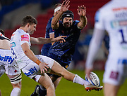 Sale Sharks lock Josh Beaumont stretches to try to charge down a kick from Exeter Chiefs scrum-half Jack Maunder during a Gallagher Premiership Round 11 Rugby Union match, Friday, Feb 26, 2021, in Eccles, United Kingdom. (Steve Flynn/Image of Sport)