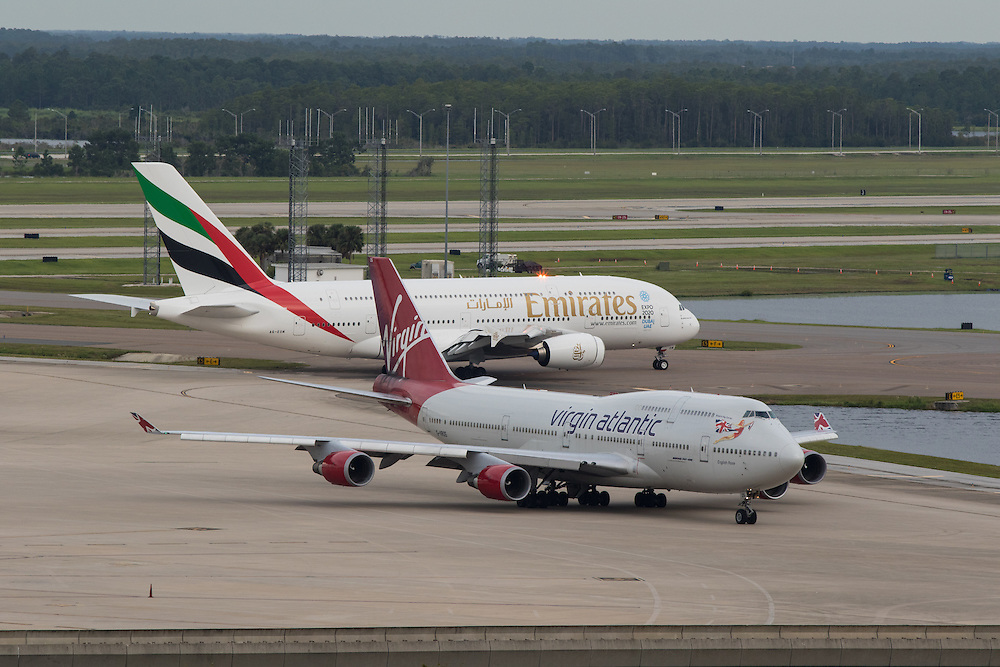 Images from the inaugural flight of Emirates 219, A388, nonstop service from Dubai to Orlando. Pictured along side a Virgin Atlantic B744.