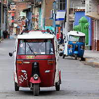 An auto rickshaw, also known as three wheeler, is one type of public transportation in Peru.