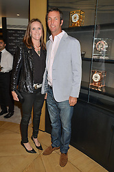 JOHN PAUL CLARKIN and NINA CLARKIN at the draw for the Jaeger-LeCoultre Gold Cup held at Jaeger-LeCoultre, 13 Old Bond Street, London on 8th June 2015.