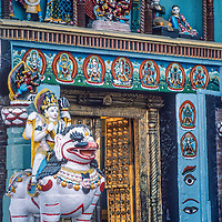 Ornate sculptures and paintings adorn the main door to Hanuman Dhoka Palace in  the Durbar Square temple complex  in Kathmandu, Nepal.