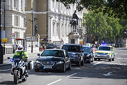 © Licensed to London News Pictures. 24/07/2019. London, UK.  A police convoy carrying British Prime Minster Theresa May travels up Whitehall to Buckingham palace where the current PM will resign. The Conservative Party has elected Boris Johnson as their new leader and Prime Minister, following Theresa May's announcement that she will step down. Photo credit: Ben Cawthra/LNP