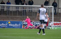 Dumbarton's Iain Russell (14, hidden) scoring their goal. half time : Arbroath 0 v 1 Dumbarton, Scottish Football League Division One played 20/10/2018 at Arbroath's home ground, Gayfield Park.