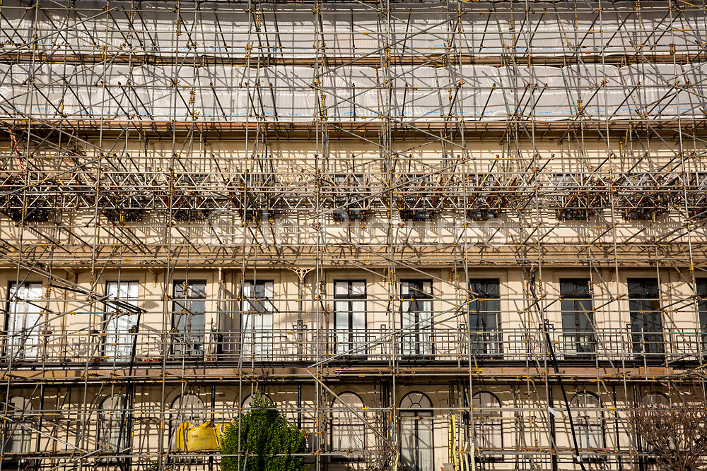 Scaffolding completely surrounds a building at a construction site on the 29th of January 2020 in Waterloo Crescent in Dover, United Kingdom. The seafront building is being completely renovated and is covered top to bottom in scaffolding.