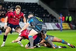 Rory Scannell of Munster  under pressure from Scott Williams of Ospreys<br /> <br /> Photographer Simon King/Replay Images<br /> <br /> European Rugby Champions Cup Round 1 - Ospreys v Munster - Saturday 16th November 2019 - Liberty Stadium - Swansea<br /> <br /> World Copyright © Replay Images . All rights reserved. info@replayimages.co.uk - http://replayimages.co.uk