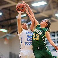Window Rock Scout Alicia Hale (25), left, attempts a field goal under pressure from Thoreau Hawk Avery Sanders (23) at the Grants Invitational girls basketball tournament at Grants High School Friday.