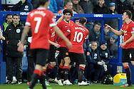 Marouane Fellaini of Manchester United celebrates with Wayne Rooney, the Manchester United captain and James Wilson of Manchester United after scoring his teams first goal of the game to make it 1-0.Barclays Premier league match, Queens Park Rangers v Manchester Utd at Loftus Road in London on Saturday 17th Jan 2015. pic by John Patrick Fletcher, Andrew Orchard sports photography.