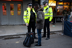 © Licensed to London News Pictures. 16/04/2021. London, UK. Police speak to a man with a portable stereo as members of the public enjoy food and drink in Soho in Central London. Earlier this week Lockdown restrictions were eased to allow non essential retail and outdoor dining to reopen. Photo credit: George Cracknell Wright/LNP