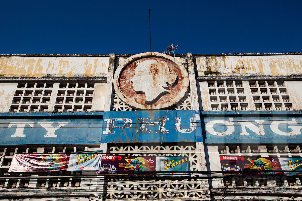 Weathered facade of an old market building in Cholon, Ho Chi Minh City , Vietnam, Southeast Asia