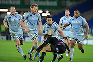 Chris Czekaj of the Cardiff Blues © is tackled by Dan Bowden of London Irish. Heineken cup rugby, pool 2, Cardiff Blues v London Irish at the Cardiff city Stadium in Cardiff, South Wales on Friday 18th Nov2011. pic by Andrew Orchard, Andrew Orchard sports photography,