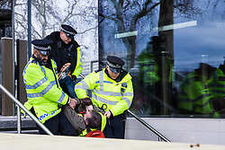 London, UK. 2nd February, 2019. Metropolitan Police officers arrest a supporter of Yellow Vests UK during a protest outside New Scotland Yard calling for 'British people to be put first', for a 'full Brexit' and for 'an end to government, court and banking corruption'.