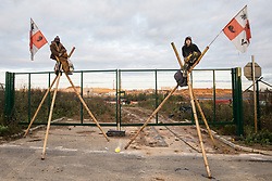 West Hyde, UK. 9th October, 2020. Anti-HS2 activists use tripods to blockade one of several entrances blocked to the Chiltern Tunnel South Portal site for the HS2 high-speed rail link. The protest action, at the site from which HS2 Ltd intends to drill a 10-mile tunnel through the Chilterns, was intended to remind Prime Minister Boris Johnson that he committed to remove deforestation from supply chains and to provide legal protection for 30% of UK land for biodiversity by 2030 at the first UN Summit on Biodiversity on 30th September.
