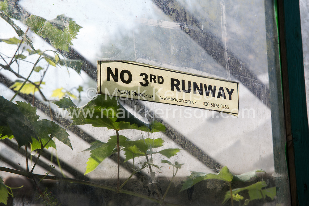 Sipson, UK. 5th June, 2018. A sticker calling for no third runway at Heathrow airport is pictured at Grow Heathrow. Grow Heathrow is a squatted off-grid eco-community garden founded in 2010 on a previously derelict site close to Heathrow airport to rally support against government plans for a third runway and it has since made a significant educational and spiritual contribution to life in the Heathrow villages, which remain threatened by Heathrow airport expansion.