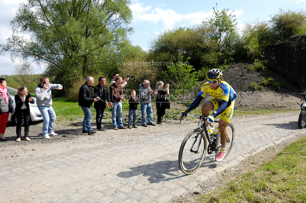 France, April 13th 2014: Michal Kolar, Saxo-Tinkoff, chases the lead group through Pont Gibus, Wallers, during the 2014 Paris Roubaix cycle race.