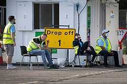 © Licensed to London News Pictures. 19/09/2020. Chessington, UK. Members of the Test & Trace staff wait for people to arrive at a Covid-19 testing centre set up in the car park of Chessington World of Adventures south west of London. The Government have faced criticism over delays in getting tested for the COVID-19 strain of coronavirus. . Photo credit: Peter Macdiarmid/LNP