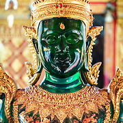 Jade buddha statue with gold detail at Wat Phra That Doi Suthep, Chaing Mai