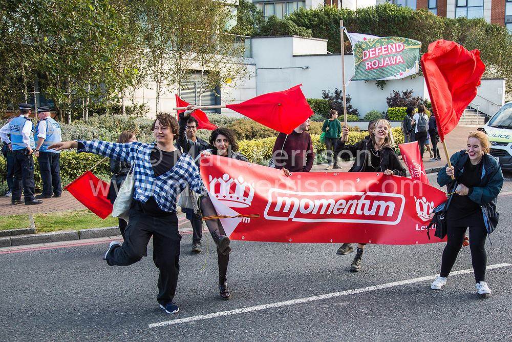 London, UK. 7 September, 2019. Momentum activists take part in a sixth day of Stop The Arms Fair protests outside ExCel London against DSEI, the world's largest arms fair. The sixth day of protests was billed as a Festival of Resistance and included performances, entertainment for children and workshops as well as activities intended to disrupt deliveries to ExCel London for the arms fair.
