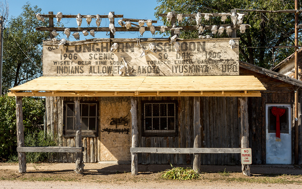 Longhorn Saloon, main drag, Scenic, South Dakota. Not just a saloon, the establishment in its heyday was also a general store, dance hall and bunkhouse. No longer open for business. Note holiday decorations, and cab stand.