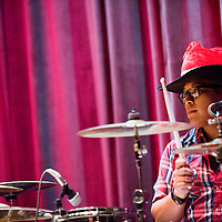 122212       Cable Hoover<br /> <br /> Drummer Kree Johns plays with Twang Deluxe during the Turquoise Classic Cowboy Christmas concert at El Morro Theatre in Gallup Saturday.