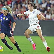 United States midfielder Julie Ertz (8) dribbles the ball in front of England midfielder Jill Scott (8) during the first match of the 2020 She Believes Cup soccer tournament at Exploria Stadium on 5 March 2020 in Orlando, Florida USA.