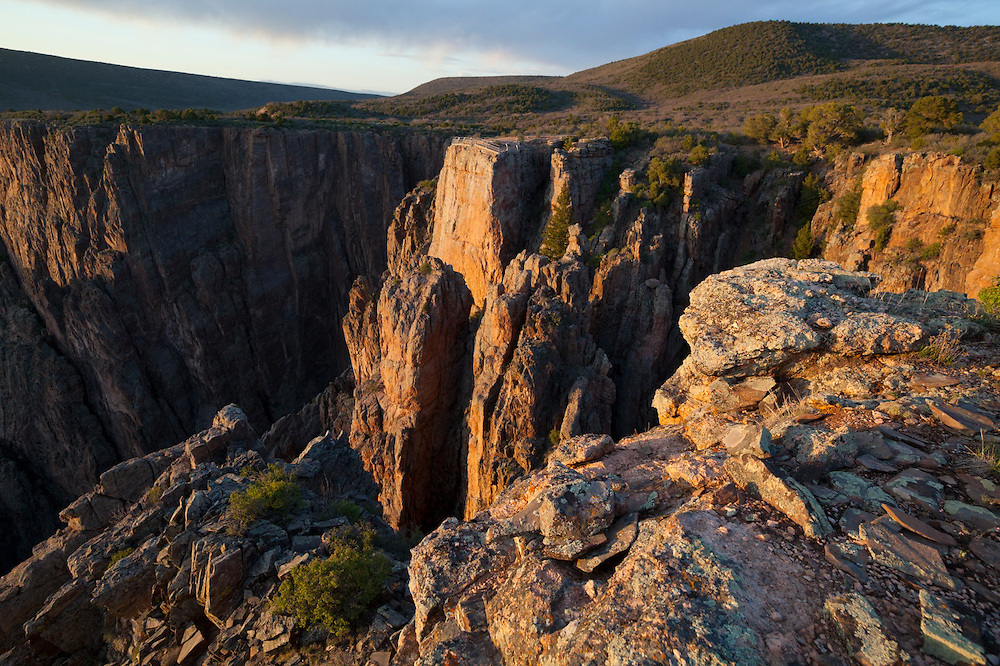The Island Peaks View overlook at sunset in Black Canyon of the Gunnison National Park, Colorado.