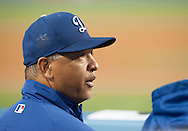 Dodgers Manager Dave Roberts looks out front he dugout during their Freeway Series game against the Angels Friday night at Dodger Stadium.<br /> <br /> <br /> ///ADDITIONAL INFO:   <br /> <br /> freeway.0402.kjs  ---  Photo by KEVIN SULLIVAN / Orange County Register  --  4/1/16<br /> <br /> The Los Angeles Angels take on the Los Angeles Dodgers at Dodger Stadium during the Freeway Series Friday.<br /> <br /> <br />  4/1/16