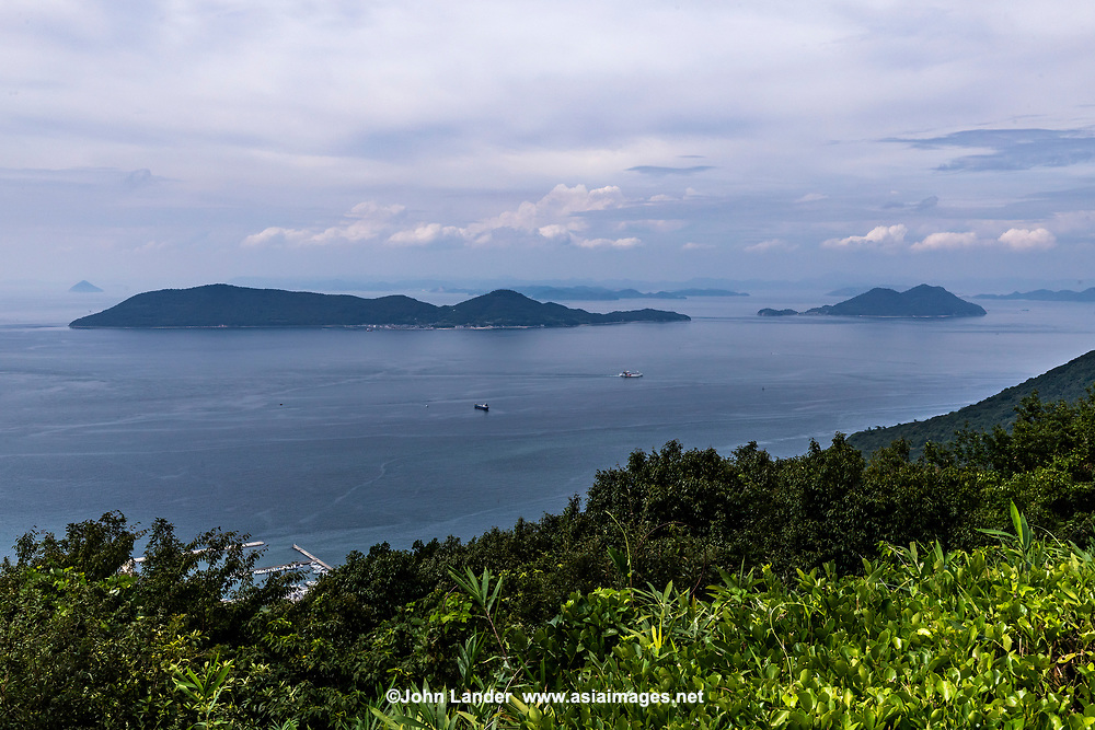 Islands seen off the coast of Takamatsu in the Inland Sea, or Seto Naikai as it is known in Japanese is the body of water separating Honshu, Shikoku  and Kyushu - Japan's main islands.  The Inland Sea, because of its calm waters and strategic location among the main islands, has always been an important transportation link for Japan.  The Inland Sea is also seen as a symbol of the heartland of Japan and in recent times a symbol of the urban flight, that is plaguing remote areas such as these islands.