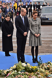 © Licensed to London News Pictures. 28/11/2018. Leicester, UK. The Duke and Duchess of Cambridge visit a tribute site nearLeicester City Football Club King Power Stadium to pay tribute to those who were tragically killed in the helicopter crash at Leicester City Football Club's King Power Stadium. Their Royal Highnesses knew the Club's Chairman, Vichai Srivaddhanaprabha, and wanted to visit the city to recognise the warmth and compassion that the people of Leicester and fans of Leicester City Football Club have shown in reaction to the accident. Photo credit: Ray Tang/LNP