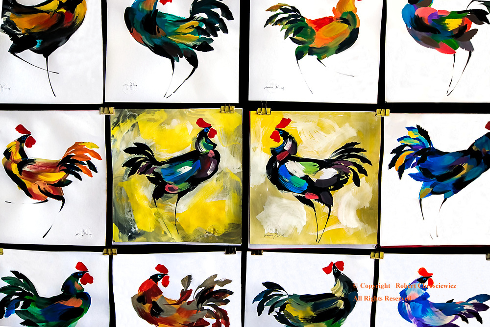 Roosters (2020 of 28)-.tif: A series of colourful paintings of roosters fills a wall, Havana Cuba.