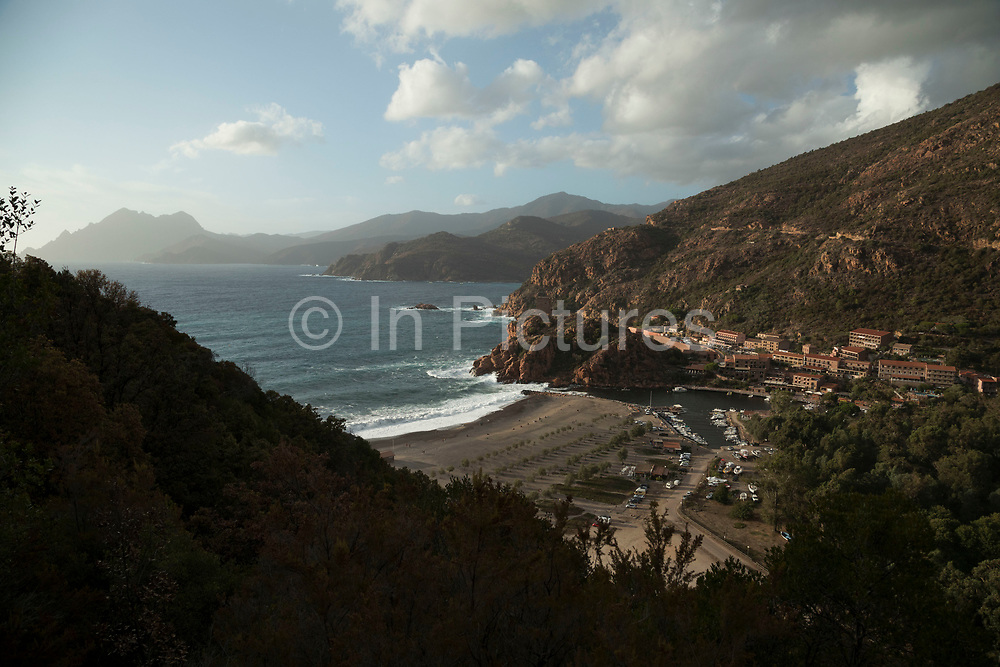 Veiw overlooking the village on 11th September 2017 in Porto, Corsica, France. Porto is a west coast village overlooking the Golfe de Porto, a tourism destination built for that specific reason. It is essentially, a port for tourist boats to moor and leave from and a series of hotels, restaurants and attractions around the beach.