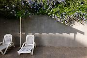 Deck-chair near private swimming pool near apartments, Santiago de Chile