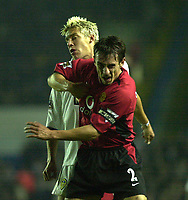 Fotball<br /> England 2003/2004<br /> Norway Only<br /> Foto: Digitalsport<br /> <br /> Leeds United v Manchester United Carling Cup (2-3) AET<br /> Alan Smith (Leeds United) gets it on the chin from Gary Neville (Manchester United)