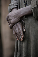 Hands of a Batwa elder - keeper of knowledge and wisdom about how to survive off the land. Batwa people were the original and first inhabitants of the rainforests of Uganda.