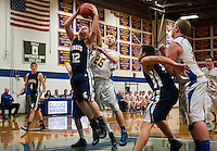 Gilford's Zack Poisson tries to block the rebound from White Mountain's Spencer Nast  during NHIAA Division III Basketball Friday evening.  (Karen Bobotas/for the Laconia Daily Sun)